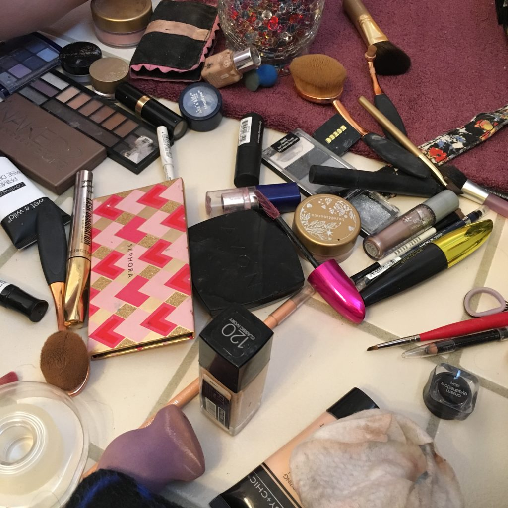 a mess of makeup supplies